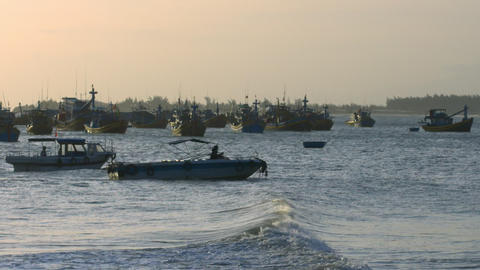 Fishing Boats in Ocean Bay Waves after Hurricane at Sunset Footage