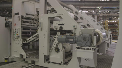 Machine Coils White Tire Material in Production Line Live Action