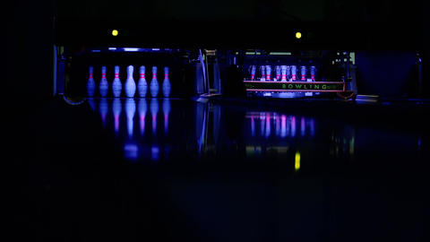 The bowling ball rolls along the path in the direction of the pins. breaks all Footage