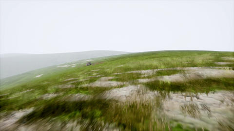 Aerial View. Sunset. Flight over a green grassy rocky hills Footage