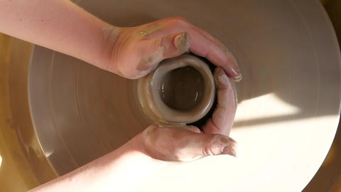 Overhead shot of clay pot being made Live Action