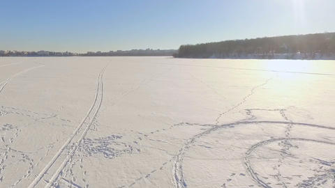 Winter landscape. Beautiful view of the winter city and the lake from a bird's Footage