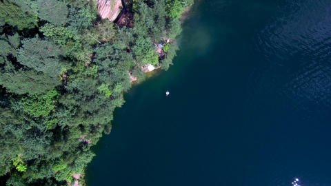people swim in the lake, have a good time, shoot from a drone, aireal view Footage