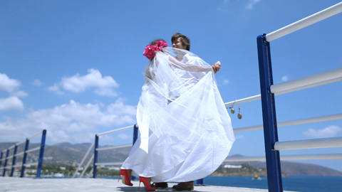 Newlywed couple performing an Wedding dance in park near sea Footage