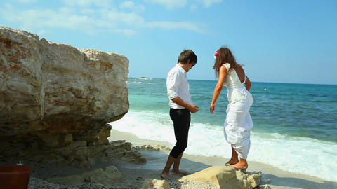 Merry newlyweds on the beach Footage