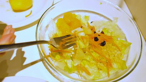 Girl eating vegetable salad close-up, 4k Footage