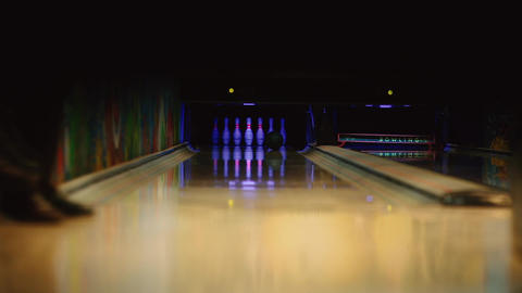 In the game club for bowling, the player throws a bowling ball that knocks down Footage