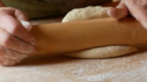 close up on pasta that is rolled out with a rolling pin Live Action