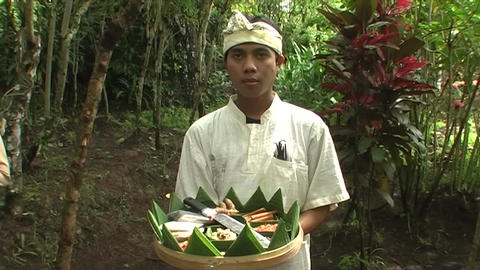 Boy in costume with spices in basket Live Action