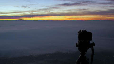 Photocamera Shooting Sunrise On The Top Of A Mountain stock footage
