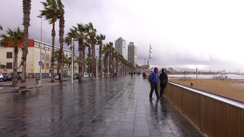POV walk along empty seaside promenade, cold keen wind at Barcelona beach Footage