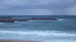 Surfers wait for good wave, stand on severe sea, strong cool breeze, rainy Footage