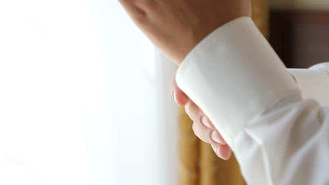 Groom buttons on his shirt cuffs Footage