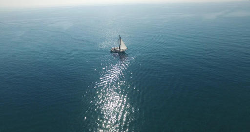 Flying Over A Sailing Boat In The Open Sea Footage