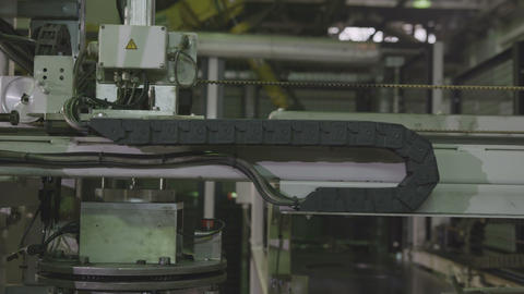 Machine Takes Tire Rim Transfers to Mark in Plant Closeup Live Action