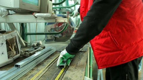 plastic windows. Worker Cutting PVC Profile with Circular Saw Footage