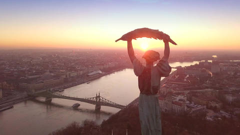 4K aerial drone footage at sunrise of drone flying around of Statue of Liberty Live Action