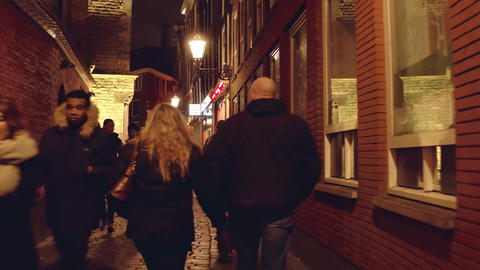 AMSTERDAM, NETHERLANDS - DECEMBER 28, 2017. Couple walking along the narrow Footage