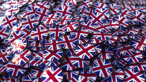 Big pile of badges featuring flags of Great Britain Footage