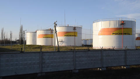 Reservoirs with fuel at the oil depot of Rosneft. Tanks in the light of the 영상물