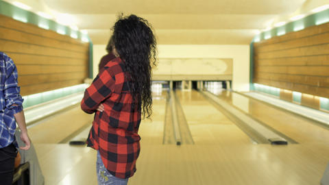 Man play bowling, his friends observes after him Footage