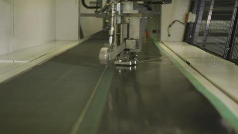 Mechanism Moves Cutting Steel Sheet in Enterprise Closeup Footage