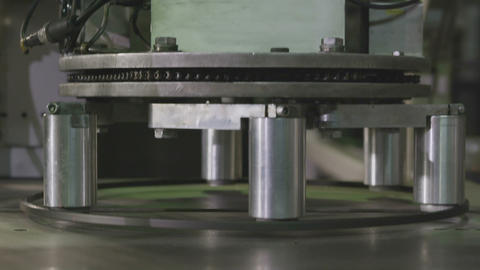Machine Takes Rim and Transfers to Marking Tool Closeup Live Action