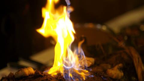 Prepared pork with fire flames at wedding ceremony Live Action