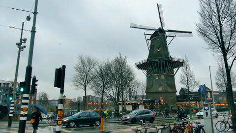 AMSTERDAM, NETHERLANDS - DECEMBER 29, 2017. Traditional windmill in the city Footage