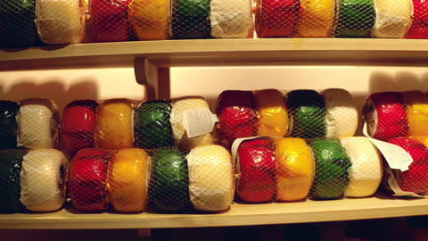 A lot of colorful cheese on factory shelf in the Netherlands Image