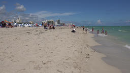 USA Florida Miami South Beach Ocean Dr waves from turquoise sea over white sand Footage
