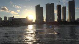 USA Florida Port of Miami Park West skyscrapers and jet skis against setting sun 영상물