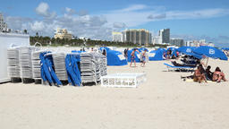 USA Florida Miami South Beach Ocean Dr stacks of loungers on white sand Footage