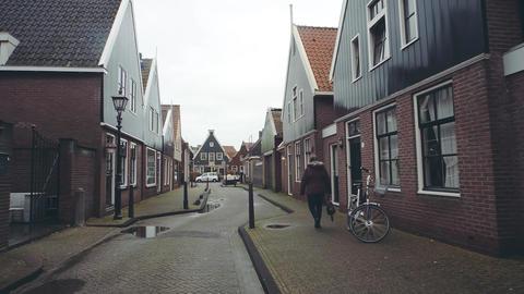 POV walk along traditional Dutch town street in Volendam, Netherlands Footage
