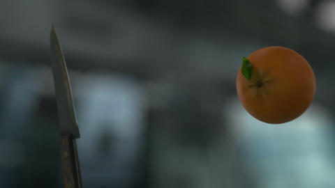 Knife Slicing Orange (With Background) Footage