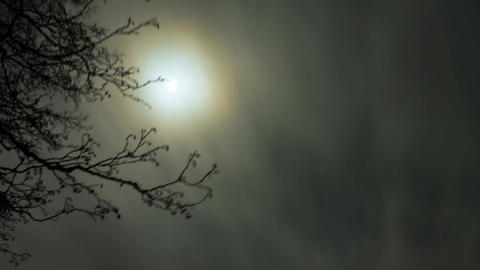 Clouds moving past the moon time-lapse Footage