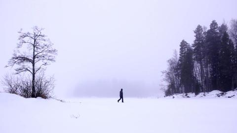 Walking across foggy frozen lake Footage