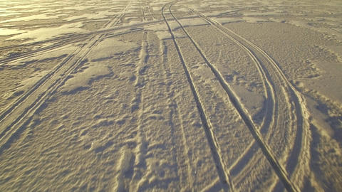 Car tracks on frozen lake Live Action