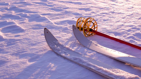 Wooden off-track skis laying on snow Footage