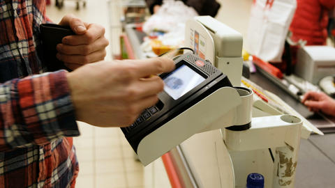 Man uses the card PayPass in the store, 4K Stock Video Footage