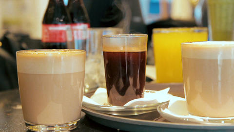 Many glasses with coffee and juice are placed on the counter in a cafe Footage