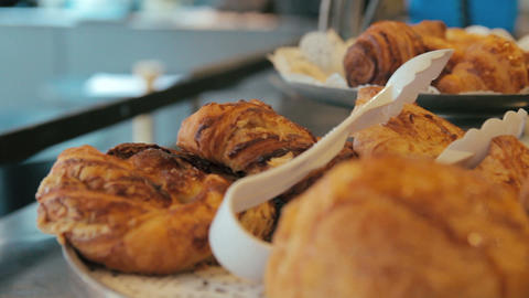Moving panning right shot of many sweet crispy croissants and rugelach placed on Footage