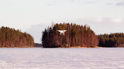Drone approaching close at a frozen lake Live Action