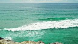 Blue Ocean Water Splashing Against Rocks On Portugal Beach Coastline 画像
