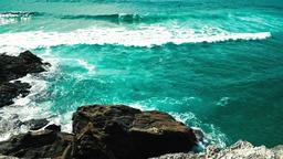 Blue Ocean Water Splashing Against Rocks On Portugal Beach Coastline Image