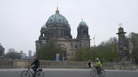 Cyclist passing by Berliner Dom Cathedral Church seen from Friedrichsbrücke Footage
