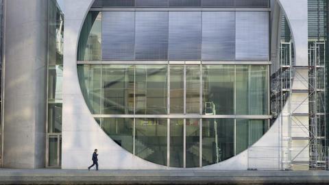 People passing by Marie Elisabeth Lueders Haus building window cricle Footage