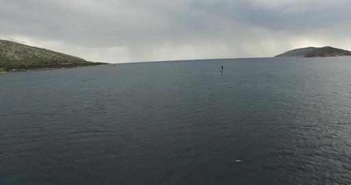 Windsurfer on the Calm Sea Surface 1 Image