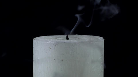 White candle is extinguished on a black background Image