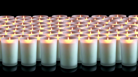 Many white candles on a black background Footage